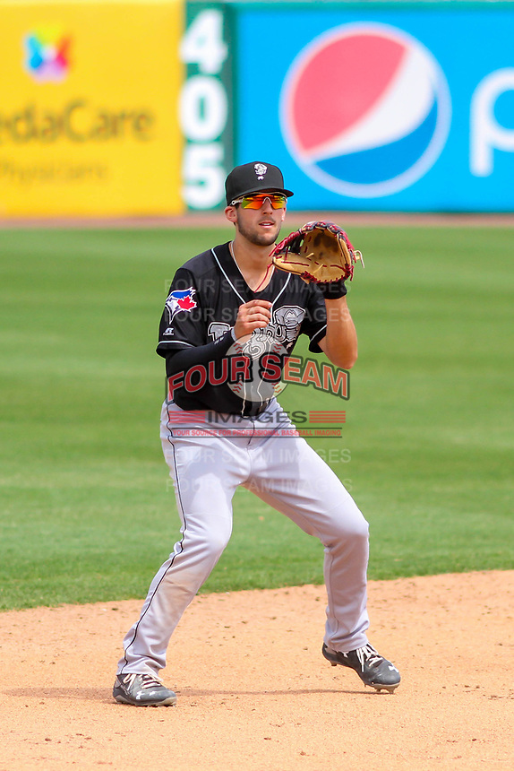 Lansing Lugnuts shortstop Kevin Smith (4) awaits a throw following a strikeout during a Midwest League game against the Wisconsin Timber Rattlers on May 8, 2018 at Fox Cities Stadium in Appleton, Wisconsin. Lansing defeated Wisconsin 11-4. (Brad Krause/Four Seam Images)