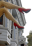 legs extend provocatively from window in San Francisco's iHaight Ashbury district.