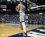 Nevada's Caleb Martin (10) passes the ball to his twin brother Cody Martin (11) against South Dakota State in the first half of an NCAA college basketball game in Reno, Nev., Saturday, Dec. 15, 2018. (AP Photo/Tom R. Smedes)