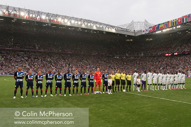 Great Britain and Senegal football teams line up on the field at Manchester United's Old Trafford stadium prior to their team's opening Men's Olympic Football tournament match at the venue. The double header of matches resulted in Uruguay defeating the United Arab Emirates by 2-1 while Great Britain and Senegal drew 1-1. Over 72,000 spectators attended the two Group A matches.