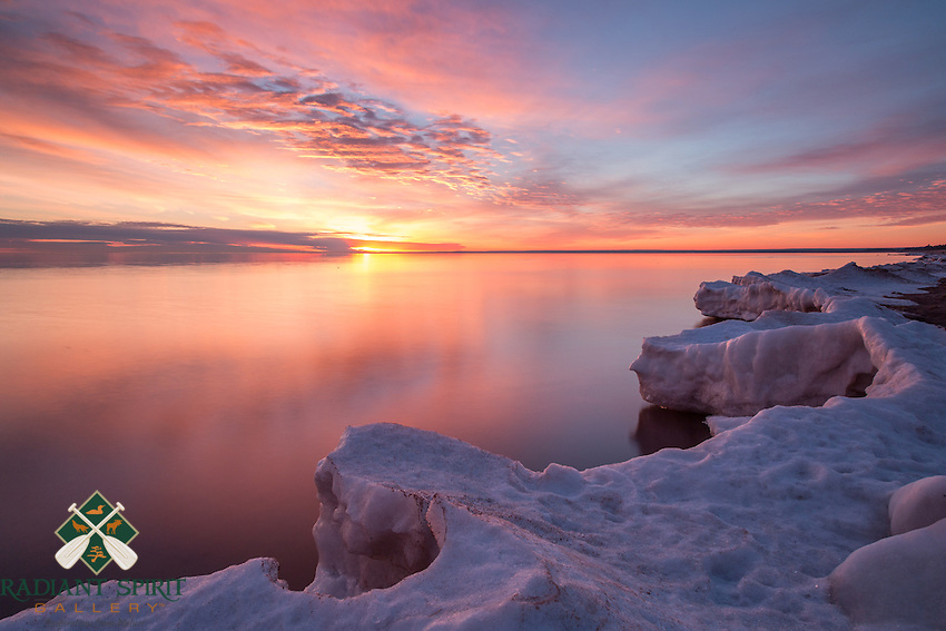 &quot;Blush&quot;<br /> The sky was filled with textures for the rising sun to paint, and we could hear the calls of a cardinal in the distance. Lake Superior's icy shoreline continues to shrink rapidly with the spring-like temperatures and rains.