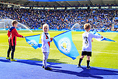 9th September 2017, King Power Stadium, Leicester, England; EPL Premier League Football, Leicester City versus Chelsea; Small boy looking for his family doing the flag waiving at the start of the game