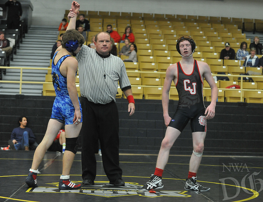 NWA Democrat-Gazette/MICHAEL WOODS &bull; <br /> Jake Turner from Rogers (blue jersey) and Tyler Church from Carl Junction High School in Missouri, compete Saturday, December 19, 2015 in the championship match in the 126 pound division at the Bentonville High School wrestling tournament.