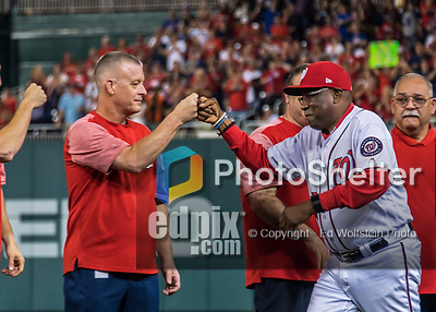 6 October 2017: Washington Nationals Manager Dusty Baker gets fist bumps from staff members during the team introduction prior to the start of the NLDS against the Chicago Cubs at Nationals Park in Washington, DC. The Cubs shut out the Nationals 3-0 to take a 1-0 lead in their best of five Postseason series. Mandatory Credit: Ed Wolfstein Photo *** RAW (NEF) Image File Available ***