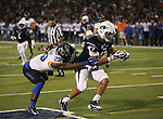 Nevada's Jarred Gipson (47) scores against Boise State's Dylan Sumner-Gardner (29) during the first half of an NCAA college football game in Reno, Nev., on Saturday, Oct. 4, 2014. Boise State won 51-46. (AP Photo/Cathleen Allison)