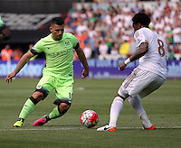 ( L-R ) Sergio Aguero of Manchester City against Leroy Fer of Swansea City during the Swansea City FC v Manchester City Premier League game at the Liberty Stadium, Swansea, Wales, UK, Sunday 15 May 2016