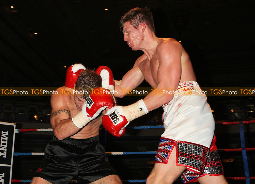 Jack Morris (white/red shorts) defeats Adam Wilcox in Super-Middleweight boxing contest at the Troxy, Limehouse, London, promoted by CityBoxer - 05/11/09 - MANDATORY CREDIT: Gavin Ellis/TGSPHOTO - Self billing applies where appropriate - Tel: 0845 094 6026