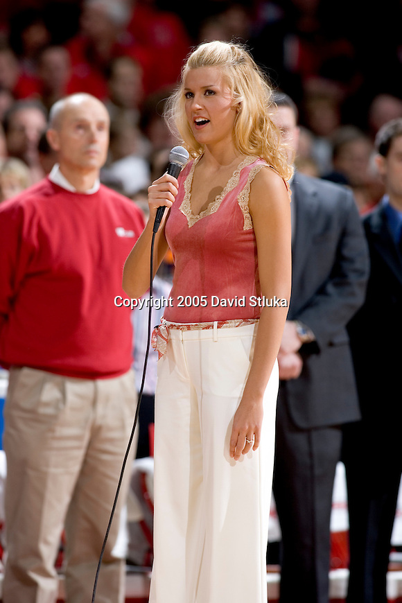 MADISON, WI - JANUARY 16:  Alexis Schrubbe, fiance to Mike Wilkinson #54 of the Wisconsin Badgers, sings the National Anthem before the Michigan State Spartans game at the Kohl Center on January 16, 2005 in Madison, Wisconsin. The Badgers beat the Spartans 62-59. (Photo by David Stluka) *** Local Caption *** Alexis Scrubbe