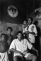 BRAZIL,El DORADO DOS CARAJAS : One Component of the Landless workers movement  leaders  with his family, in the camp, with the flag of the movement.	on 17 April, 1998  at transamazonica in Parauapebas south of Pará, northern Brazil. -  Photo by Paulo Amorim
