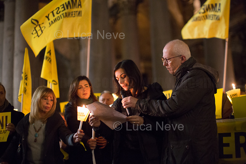 """Tina Marinari (Campaign Coordinator for Amnesty International Italia) reads the letter written by Giulio Regeni's Parents.<br /> <br /> Rome, 25/01/2020. Today, hundreds of people gathered outside the Pantheon, and in several squares across Italy, to hold a candlelit vigil marking the fourth anniversary of the disappearance of Giulio Regeni. Regeni was an Italian Cambridge University graduate (PhD student at Girton College, Cambridge) who was kidnapped, tortured and killed in Egypt while he was researching Egypt's independent trade unions. The body of the 28-year-old Cambridge PhD student was found on a Cairo road on Wednesday 3rd of February 2016. According to the autopsy, Giulio died after a vertebra in his neck was fractured. Moreover, his body - found on the Cairo-Alexandria desert road - shown signs of tortures, abrasions - including marks similar to cigarette burns - and fractures. After four years of disinformation, """"depistaggi"""", reticence, misdirections, the role of the Cambridge University and the role of the Egyptian regime of the President Al-Sisi, after four years of a very difficult investigations for the Italian Police, the Regeni's family, Amnesty International and thousands of people are still calling for the immediate truth about this brutal assassination. <br /> <br /> Footnotes & Links: <br /> http://bit.do/fqv6c (Facebook event)<br /> https://www.amnesty.it/<br /> https://www.amnesty.it/4annisenzagiulio/<br /> https://www.facebook.com/veritaegiustiziapergiulioregeni/ <br /> https://giuliosiamonoi.wordpress.com  <br /> Book """"Giulio Fa Cose"""" (Ed. Feltrinelli): http://bit.do/fqv39"""
