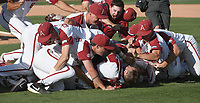 NWA Democrat-Gazette/J.T. WAMPLER The Arkansas squad dog piles on pitcher Matt Cronin after beating Ole Miss Monday June 10, 2019 during the NCAA Fayetteville Super Regional at Baum-Walker Stadium in Fayetteville. Arkansas won 14-1 and will advance to the College World Series in Omaha.