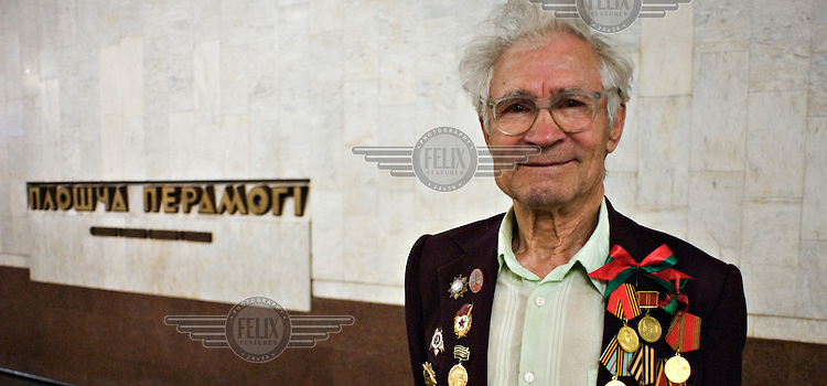 A World Word II veteran decorated with medals during celebrations marking the end of WWII..