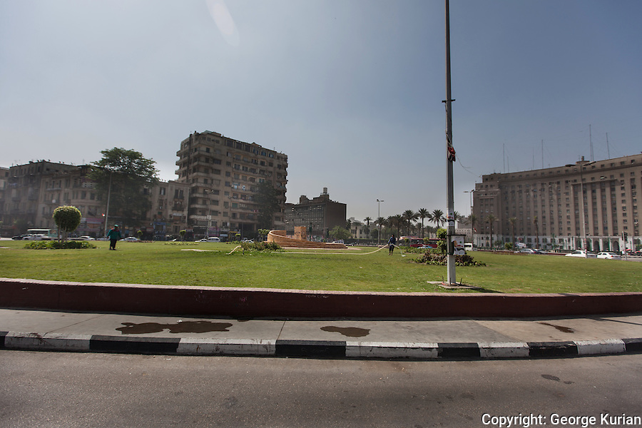 Tahrir Square and its environs was empty of people and trafiic. Tahrir Square was the main site of the revolution.
