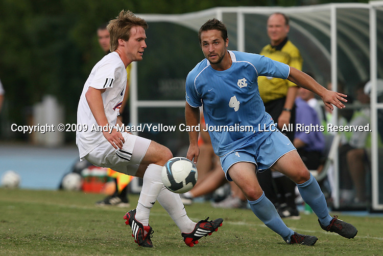 06 September 2009: UNC's Brett King (4) and Evansville's Kieran Purcell (left). The University of North Carolina Tar Heels defeated the Evansville University Purple Aces 4-0 at Fetzer Field in Chapel Hill, North Carolina in an NCAA Division I Men's college soccer game.