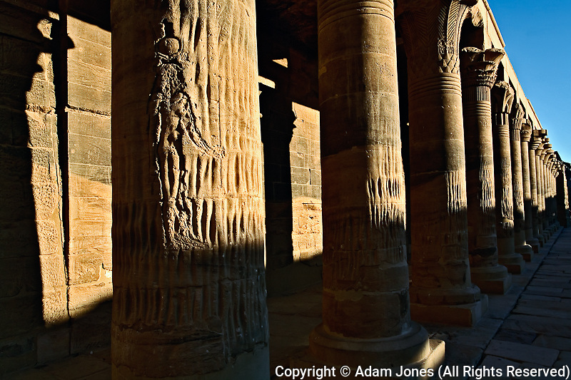 Row of columns at sunset, Temple of Philae, on Agilika, an island in the Nile River, near Aswan, Egypt.