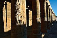 Row of columns at sunset, Temple of Philae, on Agilika, an island in the Nile River, near Aswan, Egypt.