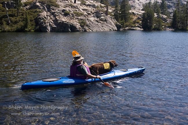 Man and his dog kayaking Lake Faucherie