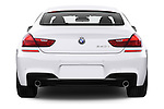 Straight rear view of 2016 BMW 6 Series 640i Gran Coupe 4 Door Sedan Rear View  stock images