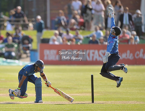 Sam Billings (Kent, wicketkeeper) jumps for the ball as L Chandimal (Sri Lanka) dives inKent v Sri Lana. 50 over tour match. The Spitfire Ground. Canterbury. Kent. England. UK. 16/05/2014. MANDATORY Credit Garry Bowden/SIPPA - NO UNAUTHORISED USE - 07837 394578