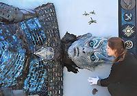 BNPS.co.uk (01202 558833)<br /> Pic: ZacharyCulpin/BNPS<br /> <br /> Ewbank's Saleroom manager, Victoria Drummond  with the embroidery<br /> <br /> A giant Game of Thrones embroidery which was commissioned to promote the popular fantasy TV show has emerged for sale for £3,500.<br /> <br /> The unique 10ft by 10ft piece, titled 'The Hardhome Embroidery', took 140 people over 30,000 hours to stitch together.<br /> <br /> It depicts a battle between the White Walker army and the people of the Wildling town of Hardhome.<br /> <br /> The Night King is the central figure, with his eyes illuminated by LED lights. Four insects feature in the design and the border includes the crests of the houses of Stark, Arryn, Targaryen, Martell, Tully, Baratheon, Greyjoy, Tyrell and Lannister<br /> <br /> The intricate needlework was produced in 2016 to promote the DVD release of the show's fifth series. It is being sold with auctioneer Ewbank's, of Woking, Surrey.