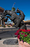 Old Scottsdale Arizona cowboy statue in tourist area 5th Avenue and  Scottsdale Road near Phoenix