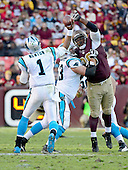 Washington Redskins nose tackle Barry Cofield (96) tries to block a pass by Carolina Panthers quarterback Cam Newton (1) in fourth quarter action at FedEx Field in Landover, Maryland on Sunday, November 4, 2012.  The Panthers won the game 21 - 13..Credit: Ron Sachs / CNP