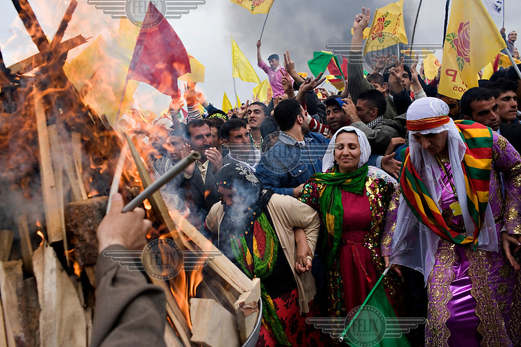 Crowds celebrate during a Newroz celebration. Newroz is celebrated by Kurds throughout the country and is the celebration of the coming of spring. ....