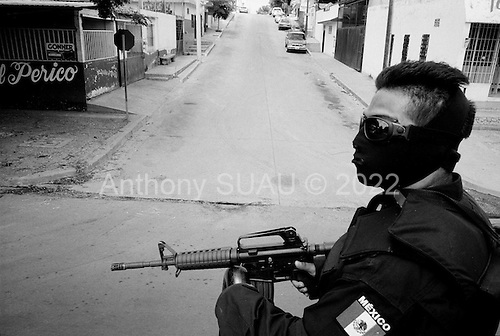 Culiacan, Sinaloa.Mexico.July 6, 2008..Dozens of armed State policeman, along with the Mexican military, patrol the city streets in a show of force in Culiacan. They set up road-blocks and travel through the poorer burrios. From January 1 to mid-July 2008 there have been 535 drug related killings in Sinolao, many of them were police officers..