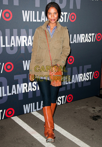 JOY BRYANT.Target and William Rast Celebrate Limited Edition Collection with Private VIP Shopping event held at Factory Place, Los Angeles, California, USA..December 11th, 2010.full length jeans denim brown tan boots satchel beige jacket.CAP/ADM/JS.©Jay Steine/AdMedia/Capital Pictures.
