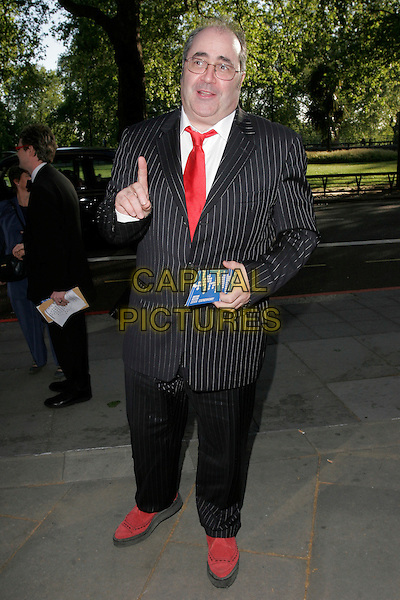 DANNY BAKER.The Sony Radio Academy Awards 2009, Grosvenor House Hotel, Park Lane, London, England..May 11th, 2009.full length black pinstripe suit red shoes hand finger tie.CAP/AH.©Adam Houghton/Capital Pictures.