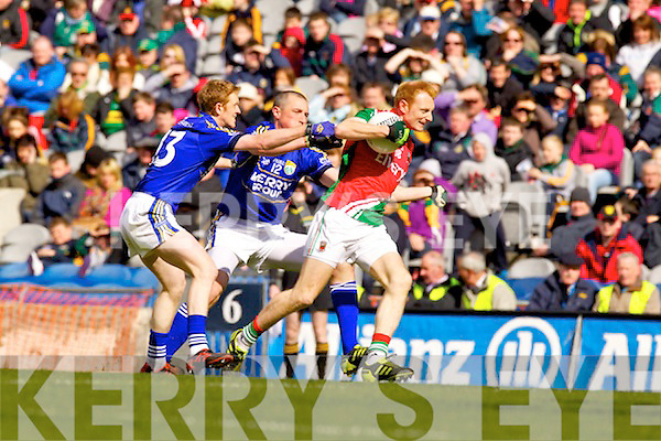 Kieran Donaghy and Colm Cooper Kerry in action against Richie Feeney Mayo in the National Football League Semi Final at Croke Park on Sunday.