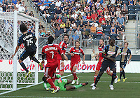 CHESTER, PA - AUGUST 12, 2012:  Gabriel Farfan (15) of the Philadelphia Union heads over in front of  Sherjill McDonald (7) of the Chicago Fire during an MLS match at PPL Park, in Chester, PA on August 12. Fire won 3-1.