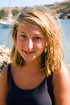 Model released portrait of smiling blonde teenage girl on holiday in the Mediterranean