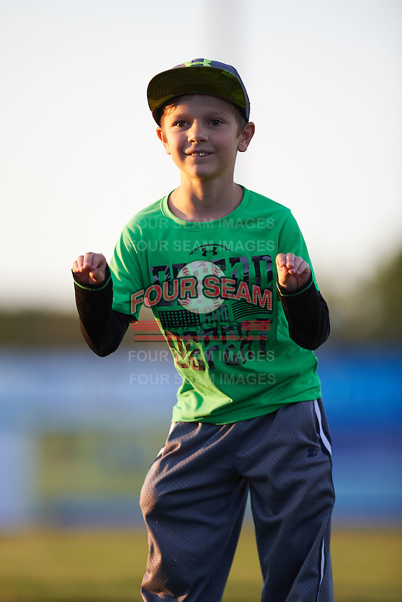 Batavia Muckdogs fan does the chicken dance in between innings for an on field promotion during the second game of a doubleheader against the Mahoning Valley Scrappers on July 2, 2015 at Dwyer Stadium in Batavia, New York.  Mahoning Valley defeated Batavia 3-0.  (Mike Janes/Four Seam Images)