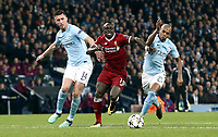 Liverpool's Sadio Mane battles with Manchester City's Aymeric Laporte (left) and Fernandinho<br /> <br /> Photographer Rich Linley/CameraSport<br /> <br /> UEFA Champions League Quarter-Final Second Leg - Manchester City v Liverpool - Tuesday 10th April 2018 - The Etihad - Manchester<br />  <br /> World Copyright &copy; 2017 CameraSport. All rights reserved. 43 Linden Ave. Countesthorpe. Leicester. England. LE8 5PG - Tel: +44 (0) 116 277 4147 - admin@camerasport.com - www.camerasport.com