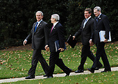 Washington, DC - October 24, 2008 -- United States President George W. Bush (L) walks with advisors toward Marine One on the South Lawn of the White House in Washington on Friday, October 24, 2008. President Bush is traveling to the National Security Agency (NSA) in Fort Meade, Maryland for a briefing. National Security Advisor Stephen Hadley (R) walks with Bush.<br /> Credit: Alexis C. Glenn / Pool via CNP