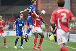 Calvin Zola of Crewe Alexandra loses out to Aldershot Town's defender John Halls during the teams League 2 match at the Alexandra Stadium. The visitors won by 2 goals to 1.