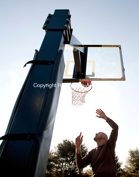 SOUTHBURY, CT-31 December 2013-123113BF01- Thomas Moccaie from Oxford shoots some hoops at the basketball courts at Community Park on Community House Road in Southbury Tuesday afternoon. Moccaie said he was talking advantage of the sunny day because the bad weather expected in the next couple of days. The former high school basketball player said he plays once or twice a week even in the winter and when it's cold outside and has been playing basketball since he was a little kid.    Bob Falcetti Republican-American