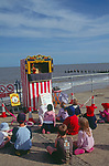 AJDM49 Punch and Judy show Southwold sea front Suffolk England