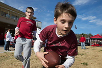 NWA Democrat-Gazette/CHARLIE KAIJO Grant May, 10 of Fredericksburg, VA (center) catches a ball with Graham Sutton, 10 of Searcy ahead of a football game on Friday, November 24, 2017 at Razorback Stadium in Fayetteville.