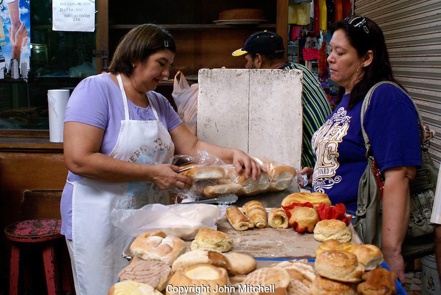 Woman buying bread in the Mercado Pino Suarez market, Mazatlan, Sinaloa, Mexico