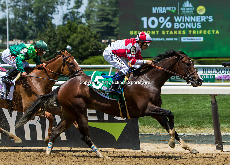 ELMONT, NY - JUNE 10: Songbird #5, ridden by Mike Smith, wins the Ogden Phipps Stakes ahead of Paid Up Subscriber #2, ridden by Javier Castellano,on Belmont Stakes Day at Belmont Park on June 10, 2017 in Elmont, New York (Photo by Sue Kawczynski/Eclipse Sportswire/Getty Images)