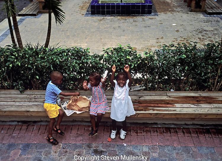 Children in Nassau in the Bahamas enjoy an impromptu lunch.