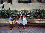 Children in Nassau in the Bahamas enjoy an impromptu lunch.