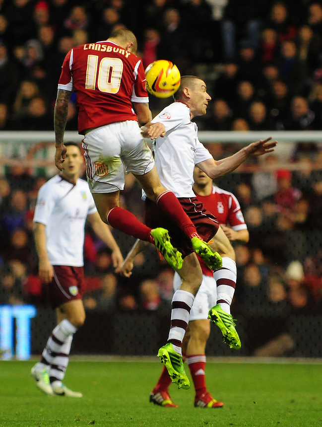 Burnley's David Jones vies for possession with Nottingham Forest's Henri Lansbury <br /> <br /> Photo by Chris Vaughan/CameraSport<br /> <br /> Football - The Football League Sky Bet Championship - Nottingham Forest v Burnley - Saturday 23rd November 2013 - The City Ground - Nottingham<br /> <br /> &copy; CameraSport - 43 Linden Ave. Countesthorpe. Leicester. England. LE8 5PG - Tel: +44 (0) 116 277 4147 - admin@camerasport.com - www.camerasport.com