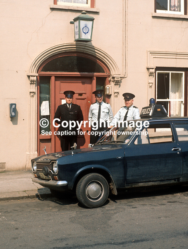 Police officers, RUC, Royal Ulster Constabulary, in more relaxed times, happily pose in front of an unfortified police station in Dromore, Co Down, N Ireland, 197109000454k..Copyright Image from Victor Patterson, 54 Dorchester Park, Belfast, United Kingdom, UK...For my Terms and Conditions of Use go to http://www.victorpatterson.com/Victor_Patterson/Terms_%26_Conditions.html