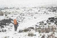 WEATHER PICTURE WALES<br /> Pictured: A man climbs the path to the summit of Penyfan in Storey Arms, Brecon Beacons in south Wales, UK. Friday 02 March 2018<br /> Re: Beast from the East and Storm Emma has been affecting most parts of the UK.