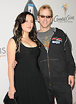 Jennifer Tilly & Phil Laak at The World Poker Tour Celebrity Invitational Tournament held at The Commerce Casino in The City of Commerce, California on February 20,2010                                                                   Copyright 2010  DVS / RockinExposures