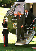 Washington, DC - October 23, 1998 -- United States President Bill Clinton exits Marine One following his return from the Washington Summit at Wye River on Thursday, October 23, 1998.  He is followed by National Security Advisor Sandy Berger..Credit: Ron Sachs / CNP