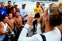 Participants celebrate after winning the Siene Boat race during St. Peter's Fiesta in Gloucester, Massachusetts, USA.